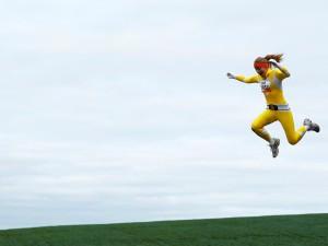 woman-runner-running-jumping-tough-mudder-race-rtr4bk4h